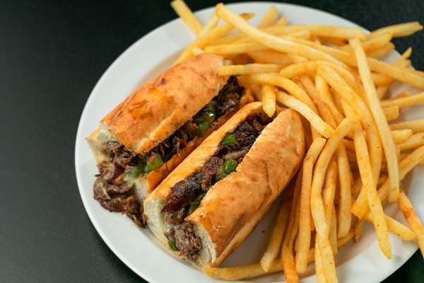 philly cheesesteak sandwhich with fries