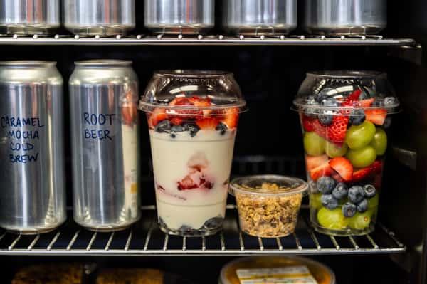 fridge of drinks and yogurt
