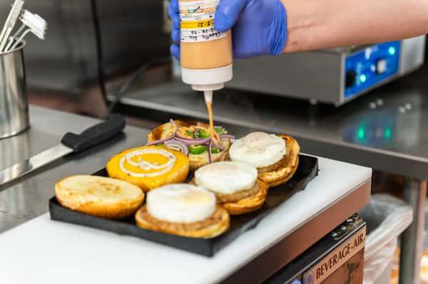Preparing breakfast sandwiches
