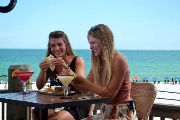 girls eating and laughing