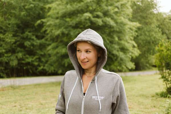 zip up grey hoodie with wordmark on left breast
