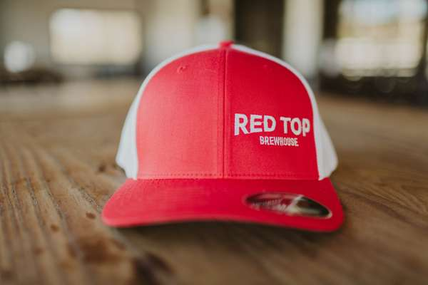 Red Top Hat with wordmark on left