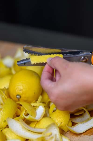 bartender prepping lemon twists