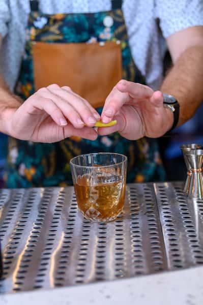bartender garnishing a drink