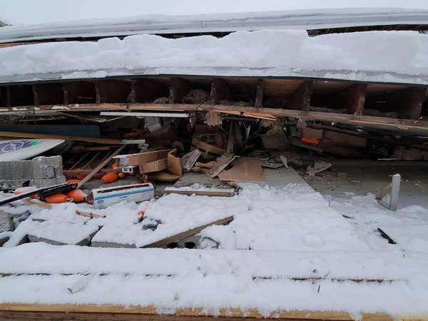 collapsed building covered in snow