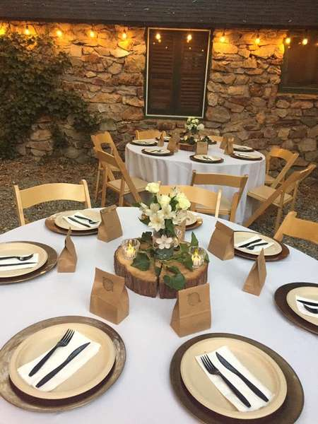 table set with paper bag favors