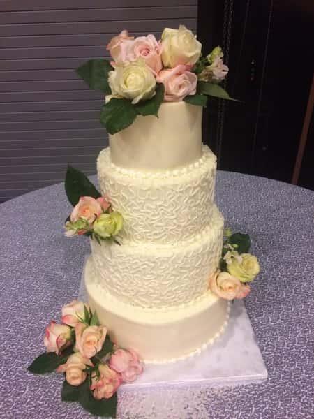 wedding cake with fresh pink roses