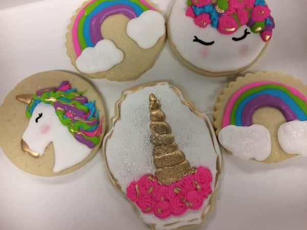 Unicorn and rainbow decorated sugar cookies