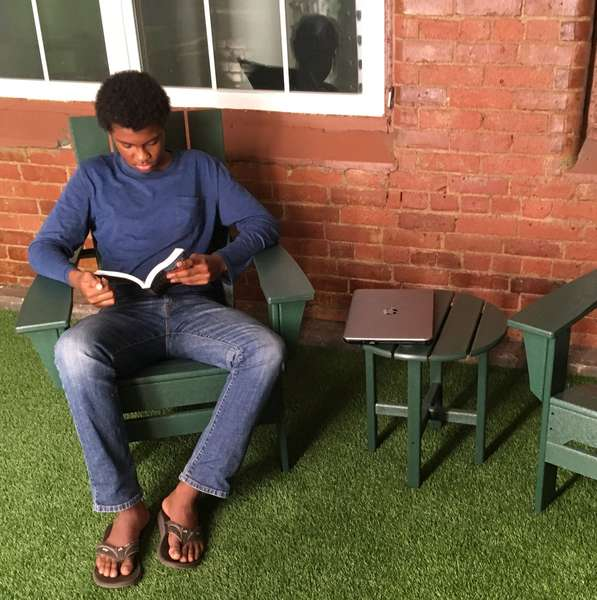 guest reading outdoors
