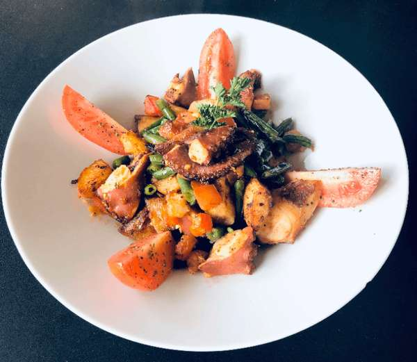 Tender Octopus cooked in paprika, roasted potatoes, green beans, fresh tomatoes
