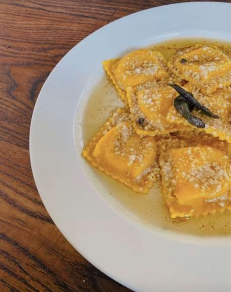 Tender ravioli stuffed with butternut squash and topped with a savory  brown butter sage.