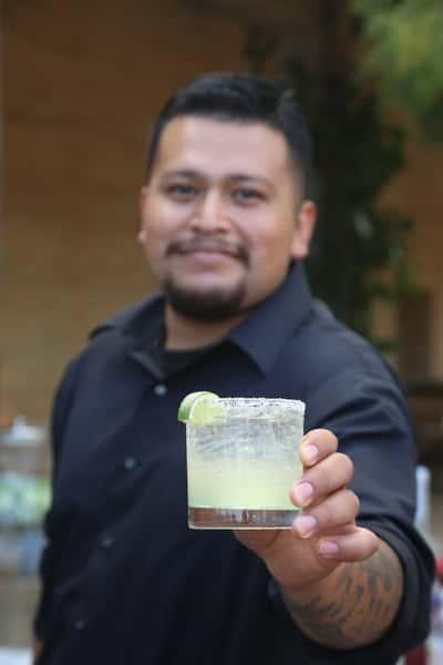 bartender holding drink