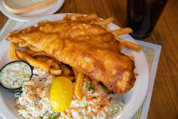 fish on a plate with fries