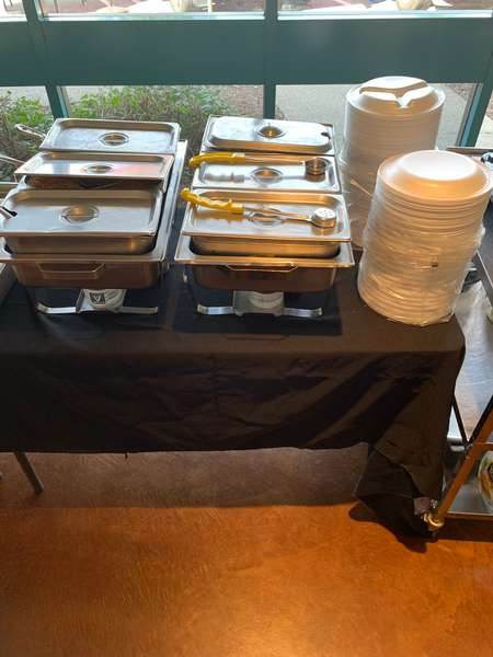 Catered pans and plates on table