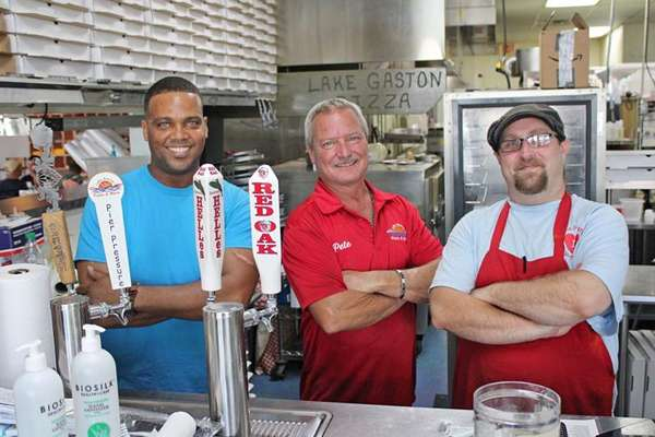 """(From left) Kerry Huff, owner Pete Richardson and Jeremiah """"Jam"""" Johnson comprise the brass of Lake Gaston Pizza & More. Huff, the general manager, and Johnson, the kitchen manager, are recent hires."""