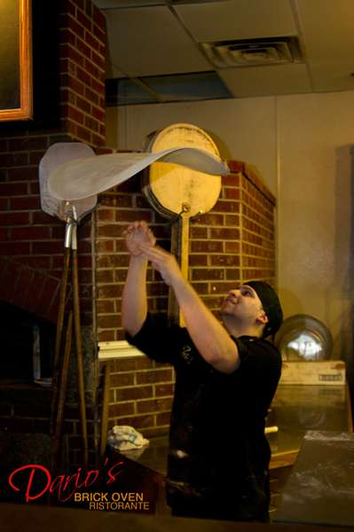 tossing the pizza dough