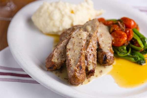 Grilled Italian Sausage Served With Roasted Peppers & Onions