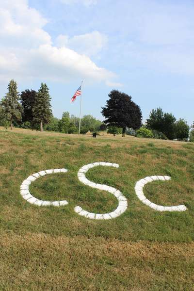 SCC written in landscaping on golf course