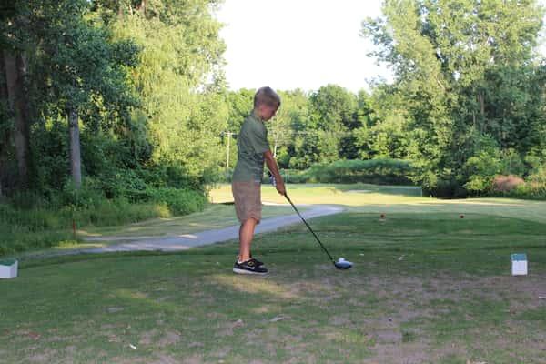 Boy at hole 12 golfing