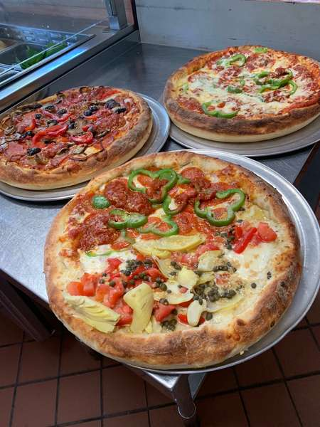 assorted chicago pizzas