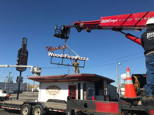 craning the new sign on