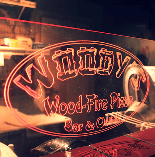 Woody's Wood-Fire Pizza Bar & Oven light up sign