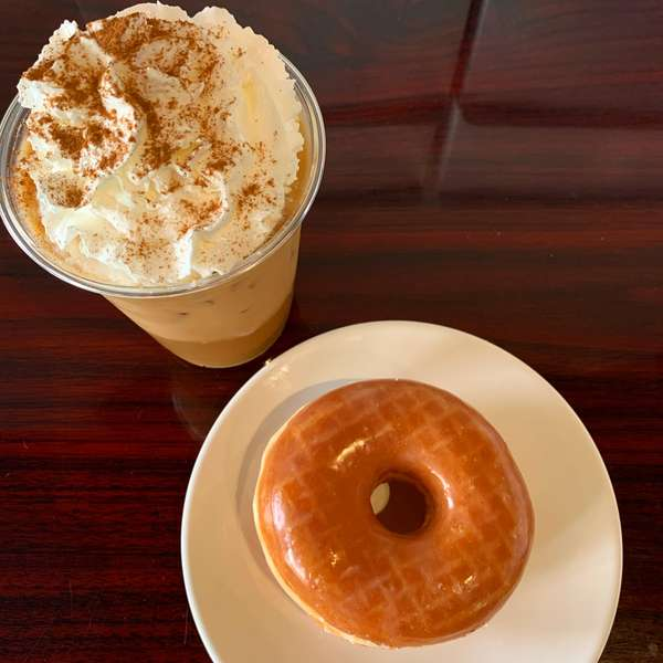iced latte pairs well with a fresh glazed doughnut