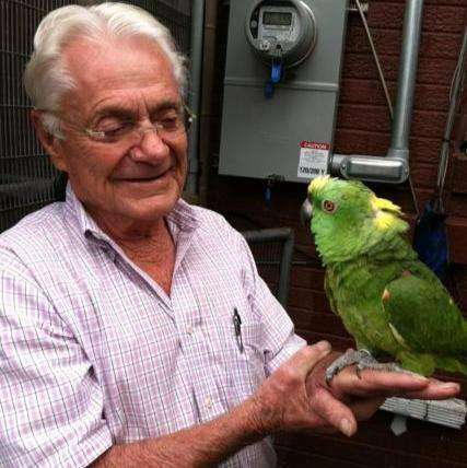 man and parrot