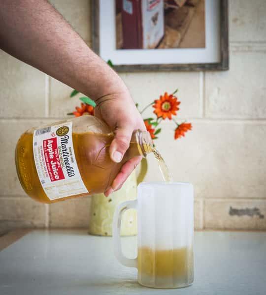 pouring frozen apple juice