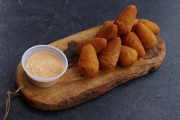 mashed potato cone bites with sauce