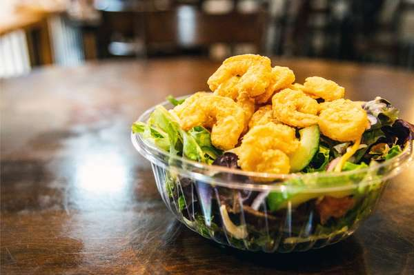 House salad topped with Fried Shrimp