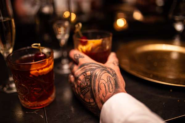 Hand on cocktail