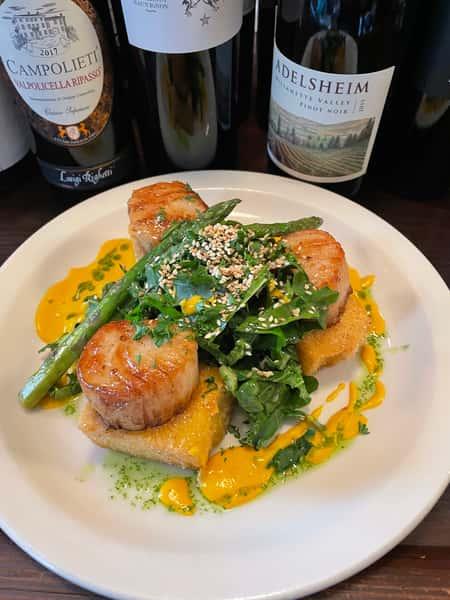 Pan Seared Colossal Sea Scallops . Crispy Goat Cheese Grit Cakes . Sesame Kate & Chard Salad . Cardamum Carrot Sauce . Asparagus