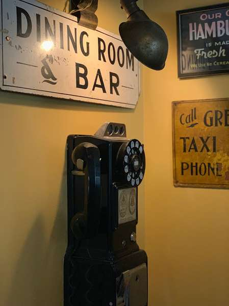 Old school pay phone with wall art