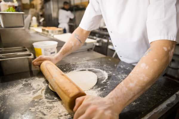 chef making pizza dough